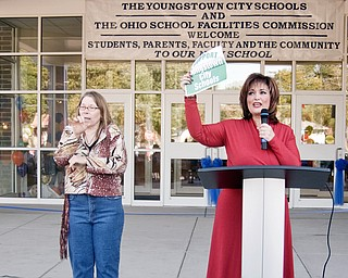 SHOWING SUPPORT: An interpreter, (left), signs to the crowd as Paul C. Bunn Principal Maria Pappas, (right), gives her speech during Sunday afternoon's ribbon cutting for the new elementary school. Pappas discussed a push to increase public support for a school levy that will appear on the ballot in November.