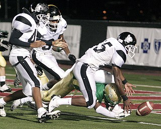 Buchtel Griffin Kash King (5) is forced into his own end zone in order  to stop Ursuline Fighting Irish Wade Daniels (24) from scoring a touchdown.