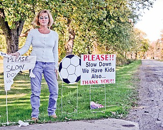 Carolyn Marinelli lives on Miller Road in Poland Township. The recent opening of Poland Township Park has brought in 1,000+ cars for the soccer games. Her petition is about the speeding and congestion. Every day life has been shaken up by the speeders and some people have gone as far as to shred her hand made sign.