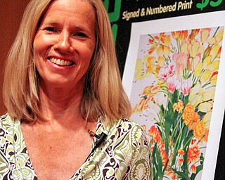 """GARDEN GURU: HGTV's Erica Glasener, standing, spoke to garden enthusiasts Saturday in a presentation of """"On the Road with a Gardener's Diary"""" at Mill Creek MetroParks' Fellows Riverside Gardens. Glasener, host of HGTV's """"A Gardener's Diary,"""" is also an author."""