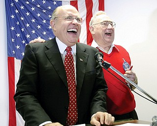 "McCAIN MOMENTUM: Rudy Giuliani, the former New York City mayor and one-time presidential candidate, is welcomed by Clarence ""Sonny"" Smith to the Mahoning County Republican Party headquarters. Giuliani made stops in Boardman and Warren on Tuesday to campaign for John McCain, GOP nominee for president."