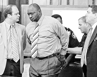 GUILTY MAN: A jury in Mahoning County Common Pleas Court found Bennie Adams, center, guilty of the aggravated murder of Gina Tenney almost 23 years ago. He's handcuffed by deputy sheriffs as his defense team, Lou DeFabio, left, and Tony Meranto, watch.