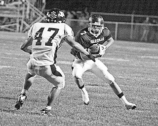BOARDMAN-PERRY - (7) Ken Jones of Boardman makes a move on (47) Logan Wannar during their game Friday night in Boardman.