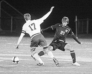 CANFIELD - GLENOAK - (21) Nate Merhaut of Canfield tries to stop (17) Spencer Semple during their game Wednesday night.