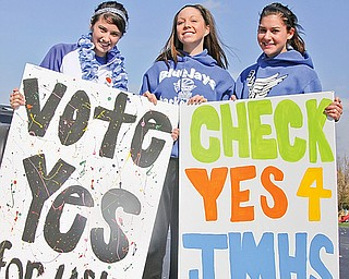 L-R Jessica Ripple (16) of Lake Milton, Brianna Vayner (16) of Lake Milton and Morgan Pinney (16) of North Jackson hold signs they made for the levy to be passed on Nov 4th. Sunday October 26, 2008