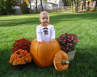 Audrey Solvesky, 8 months, takes her place as a Halloween decoration. She's the daughter of Katie Solvesky of Boardman.