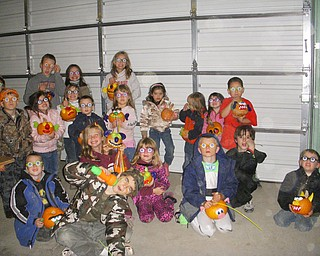 Attached is a photo taken at Countryside Farms in Poland, Ohio when the National Slovak Society's Assembly 731 held their annual Halloween Hayride for members and friends.  Following their hayride, the kids picked a pumpkin from the pumpkin patch and then decorated them with funny faces. Josie, Marlie and Tod Applegarth (New Springfield) Shae and Mikayla Hanley (New Springfield) JJ and Jake Williams (Petersburg) Layla and Olivia Taylor (Poland) Bella Cathline (Poland) Michael, Bridget and Natalie DiVencenzo (Struthers) Logan Johnson (Struthers) Tiffany Harter (North Lima) Christian Burns (North Lima) Savannah and Tyler Wymer (North Lima) Andrew and Nicholas Cessna (Boardman)
