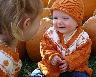 Sydney, 3, and Kennedy, 7 months, enjoy playing in the pumpkin patch at Whitehouse Farms.  Parents are Todd and Jacey Henderson of Poland.