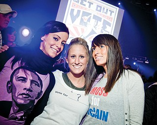 L-R Obama supporter Claudia Bucilli, 24, of Poland, the undecided Lindsey Salinsky, 23, of Canfield and McCain Supporter Jessica Moss, 28, of Boardman. Rock the Vote Concert at the Chevy Centre Wednesday, October 29, 2008.
