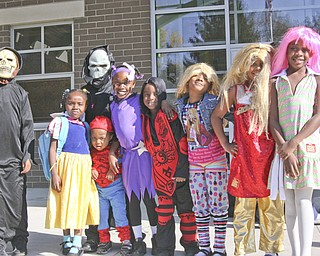 Students at Harding Elementary School on Youngstown's North Side, including these children of brothers Gary and Marvin Walker,  dressed in costume for Halloween Friday. Teachers joined in the fun and led the whole school on a parade up Fifth Avenue Friday afternoon.