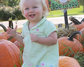 Chad and Alyson Zwingler of Canfield sent a picture of their daughter, Payton, 15 months, having lots of fun in the pumpkin patch.