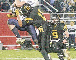 CRESTVIEW - KIRTLAND - (13) Jakob Leon of Crestview puts a big hit on (81) Anthony Ritossa as (9) Adam Britton comes in  to help during their game Saturday night in Niles.