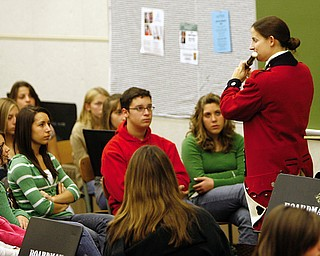 OLD GUARD: Rebecca Davidson plays the fife for band members at Boardman High School. She explained the difference between her fife flute and baroque flute, two of the instruments used in the Army Old Guard Fife & Drum Corps.