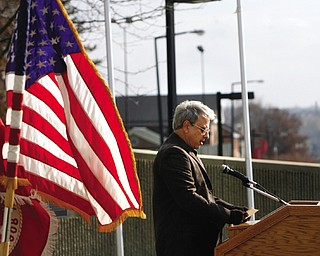 Jim Olive reads some of the 64 names of YSU students and faculty killed while on active military duty as part of a Veterans Day ceremony on campus.