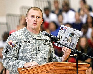 Tommy Rieman, who received a Purple Heart medal after getting shot up in Iraq. speaks to Liberty students at the Veterans Day Ceremony- he told about his experience in Iraq - and of being in a recruiting video as well as an Action figure