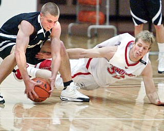 YSU's Tom Parks and Geneva's Richard Colick go for a loose ball.