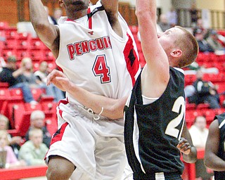 Vance Cooksey of YSU shoots past  Dave Phillips of Geneva during Tuesday exhibition game.