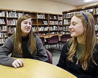 South Range Senior Hilary Skidmore, left, talks with frershan Melissa Melnick. They are involved in a program at the school called Sisterhood which pairs seniors with freshman.