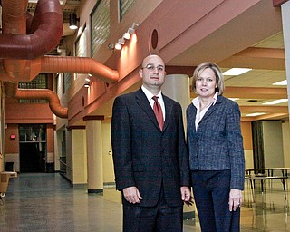 President of the Schools' Govening Authority Anthony D'Apolito and Judge Theresa Dellick of Juvenile Justice Center stand near the cafeteria at the new Mahoning County High School located at 3321 Hudson Ave in Youngstown.