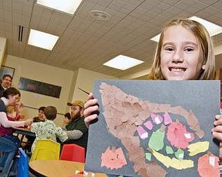 Angela Gaca, 6, of Austintown shows off her final product at the Butler Museum of American Art Children's Day.
