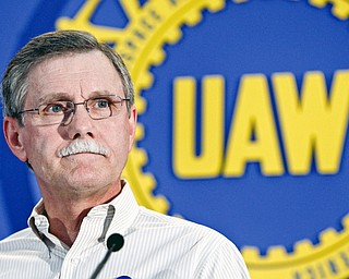 In this Oct. 7, 2008 file photo, United Auto Workers president Ron Gettelfinger talks to reporters in Detroit. Even as Detroit's Big Three automakers teeter on collapse, Gettelfinger says workers will not make any more concessions and that the getting the automakers back on their feet means figuring out a way to turn around the economy.