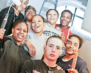 LENDING A HAND: Students of the Youth Building Mahoning County volunteered their time to help the Positive People Group at Oak Baptist Church. General cleaning and paiting were the order of the day at the church. PPG is an organization of positive-minded individuals.