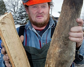 Bill Spithaler of Gustavus Hardwoods shows some firewood.
