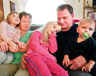 Tabitha Fiorenza, 7, center, heart recipient with family sister Hayley, 5, mom Lori, dad Mike and brother Alex, 13 months in their Struthers home.