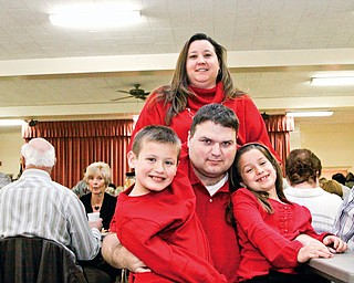 Heather Kutsch in back with her family, L-R Hunter (9), Mike and Maddison (7) at Girard First United Methodist Church for a spaghetti dinner benefit for Mike Kutsch who was diagnosed with Huntington's Disease 8 years ago Sunday.