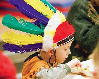 George Cottrill - kindergarten student at Jackson Elementary in Niles donned an authentic Chiefs hat as the elementary school had Turkey and the fixings and songs afterward.
