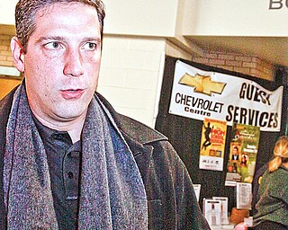 Congressman Tim Ryan speaks about the support for the auto industry during the rally at Chevy Centre Friday