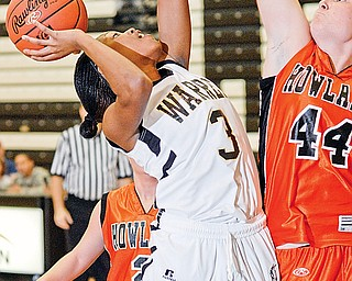 Harding's Ronisha Howard (3) tries to shoot over Howland's Kelly Barzak (44) during their game at Harding on Friday night.