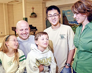 Ursuline football coach Dan Reardon with his children Emma and Matthew, wife Amanda and exchange student John Dong from Bejing who is staying with the Reardons.
