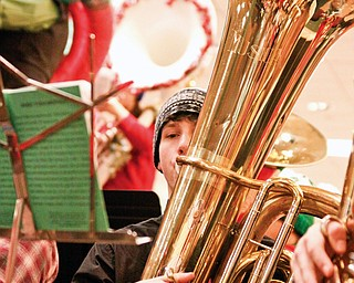 Hubbard Senior Jeff Yocum (17) plays a concert tuba for Tuba Christmas in the main concourse of Eastwood Mall in Niles.