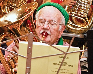 Ted O'Connor (84) of Youngstown is the eldest tuba player at Tuba Christmas in the main concourse of Eastwood Mall in Niles, Saturday.