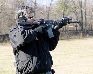 READY, AIM: Lt. Robin Lees, commander of Mahoning Valley Law Enforcement Task Force, fires downrange to help demonstrate the ShotSpotter gunshot location system.
