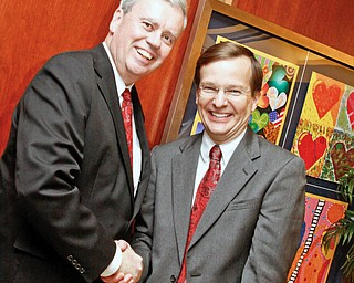 Akron Children's CEO Bill Considine and HMHP CEO Robert Shroder shake hands in the main entrance of Akron Children's Beeghly Campus on Market street in Boardman for the VIP tour of the hospital, Wednesday December 3, 2008