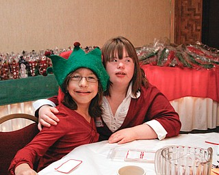 New friends Vanessa Vrabel (11) of Youngstown and Courtney Daniels (17) of Warren take a break from dancing at the annual Winterfest Dance at Mahoning Country Club in Warren, Wednesday December 3, 2008