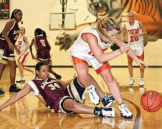 HOWLAND - LIBERTY - (2) Abby Nicholas of Howland gets tangled up with (34) Bianca Rozenblad of Liberty during their game Wednesday night.