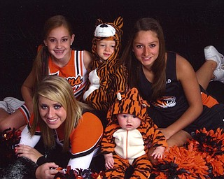 Clockwise from the left, Jordan Pesher, Raylor Remner (Sprinfield Local cheerleaders), Jacob Wiery (a mascot), Morgan McMurray (track member) and Ashley Rupert (mascot). Shelly Remner sent the photo and says the crew loves getting together for sporting events.