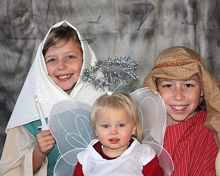 Payton Zwingler (16 months) of Columbiana and her cousins Noah (11) and Grace Cope (8) of Knoxville, Tenn., enjoyed putting on a holiday skit.Photo submitted by Chad and Alyson Zwingler
