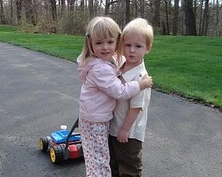 """Here is my daughter Gracie Pesa 3 1/2 years old with her best friend Benjamin Evankovich of Boardman  2 1/2 years old. The picture was taken by Ben's Dad Gary Evankovich. When asked what they were doing, Gracie said """"we're getting married"""". — Lori Pesa of Liberty"""