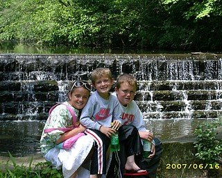 Brooke, Carson and Jackson Lambert gather in the spring at Mill Creek Park.  It would be great to see these in the paper.  Photo sent by a proud mom,  Julie Lambert.