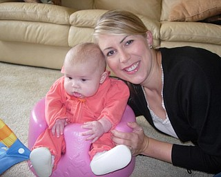 Emma, 4 months, was visiting her grandparents, Loren and Mag Mitchell, Uncle Jason and Aunt Kimberly with her parents, Gordon and Cara Petkosh in Canfield for Thanksgiving. Cara Petkosh, the Mitchells' daughter is pictured with her.