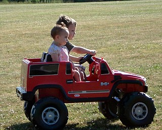 Logan and Abby Lordi taking a ride in Logan's new car that he got for his birhday.    They are our grandchildren  ( Frank and Crystal Lordi  of Newton Falls are the parents)  Marianne B Lordi, Youngstown