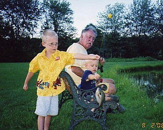 Uncle Jim Theisler shows Mason and Braden a thing or two about fishing at a pond in Coitsville. The boys were visiting from Wisconsin. Photo from Jean Roche of New Middletown.
