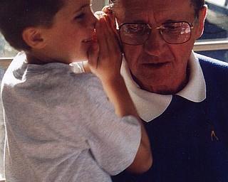 Matthew Di Ianni shares a secret with grandpa Paul McIntire of Youngstown.