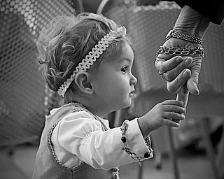 """This shot is of Hannah (16 mos) holding the hand of her Grandma (PhyllisLaPlante) at a birthday party last week. Hannah is """"Nanni's"""" little girl,right down to the love of jewelry!  The picture was taken by Hannah's dad(Phyllis's son) John.Thanks for such a great feature!Laurie LaPlante"""