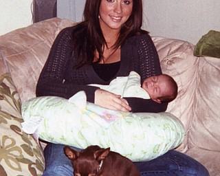 Melinda Holtzman with her first child, Allen Jr. (born Oct. 25), and her chihuahua, Nino. Vicky Hoffman of North Lima was visiting her daughter, Melinda, in Charlotte, N.C.