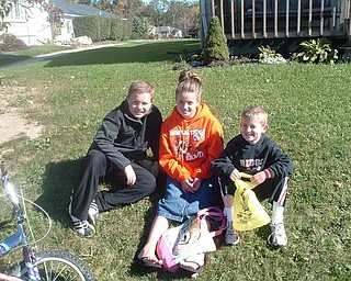 Brooke, Carson and Jackson Lambert waiti on the grass for the Mineral Ridge Parade on Route 46 in October. Photo sent by their mother, Julie Lambert.